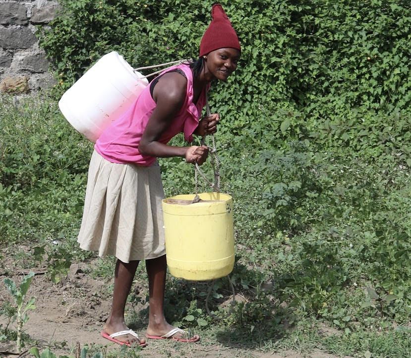 Image 11 Woman Carrying Water