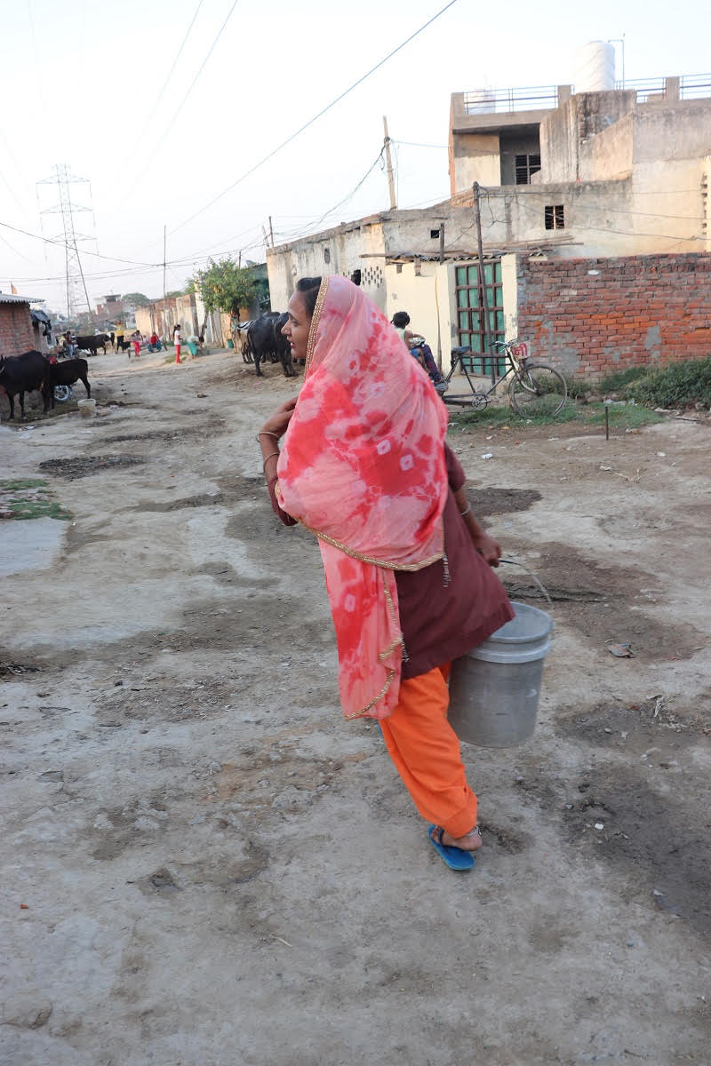 Image 6 Woman Carrying Water frm Behind