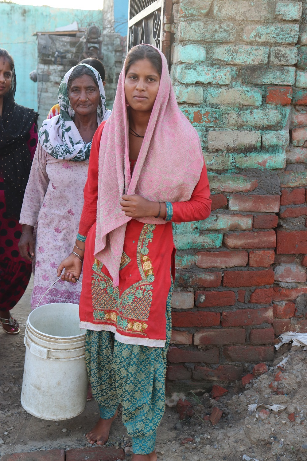 Image 3 Women with Bucket Govind Singh Mohalla