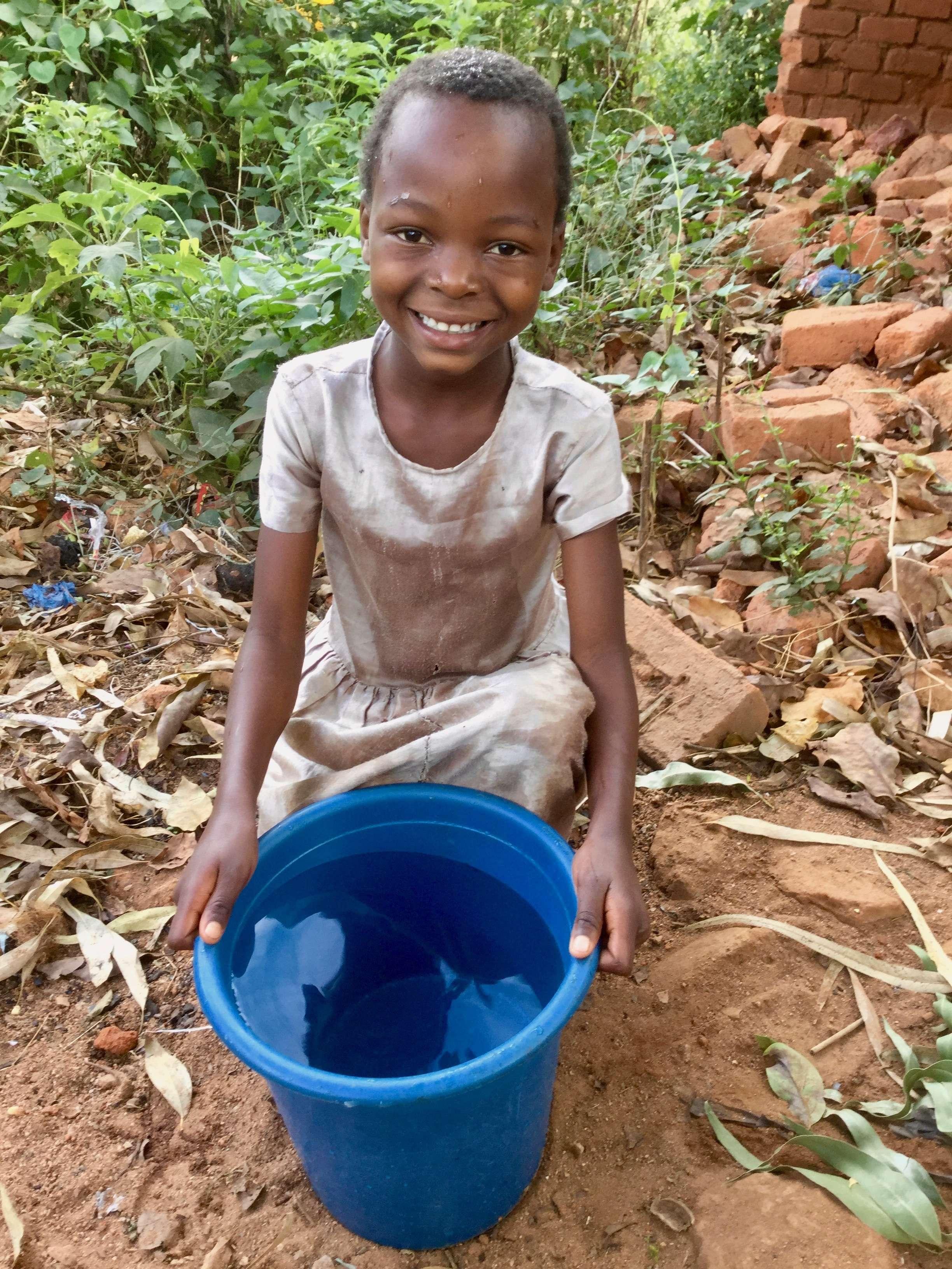 Image 4 Girl with Water Bucket