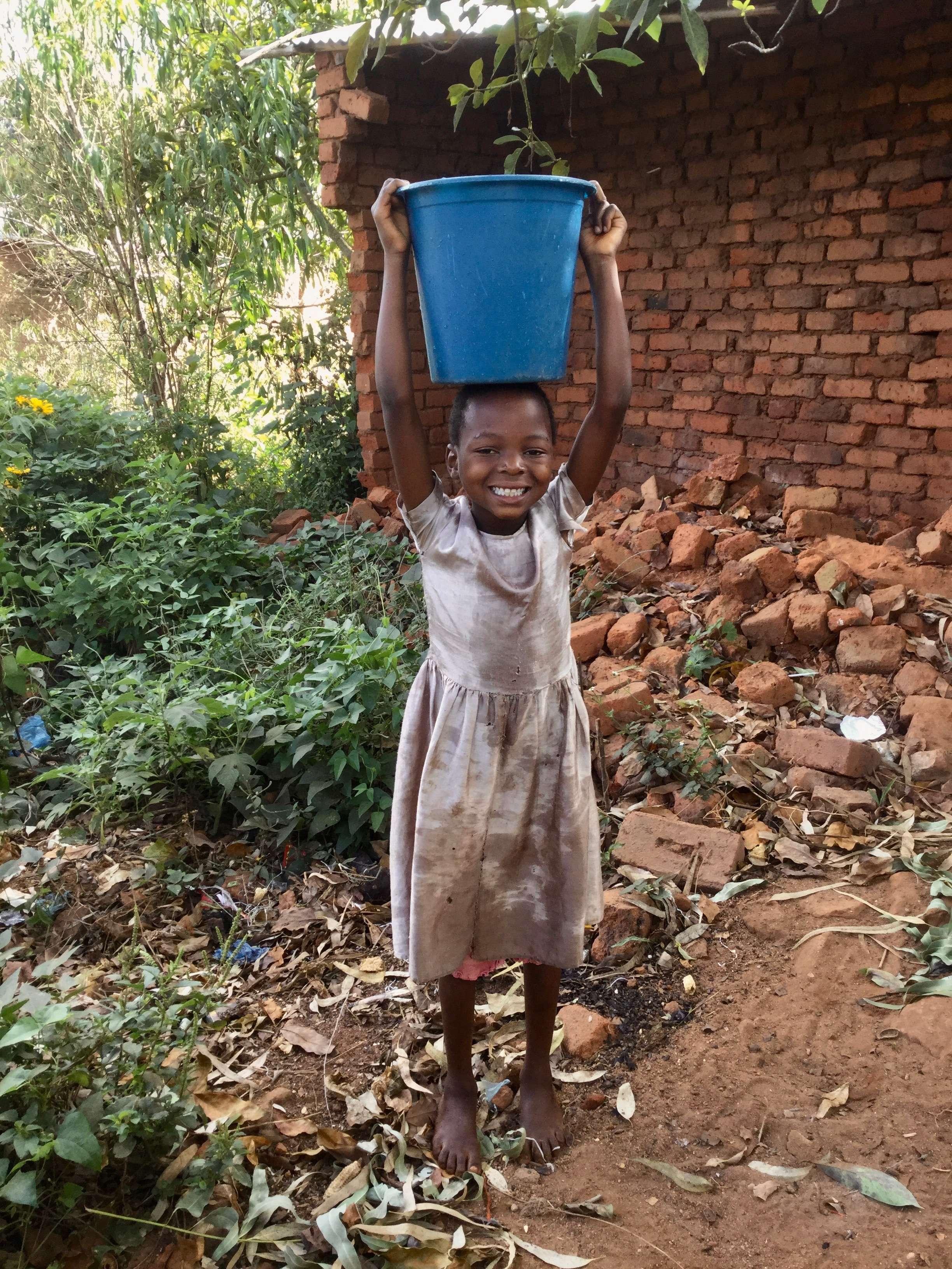 Image 5 Girl With Bucket on Head