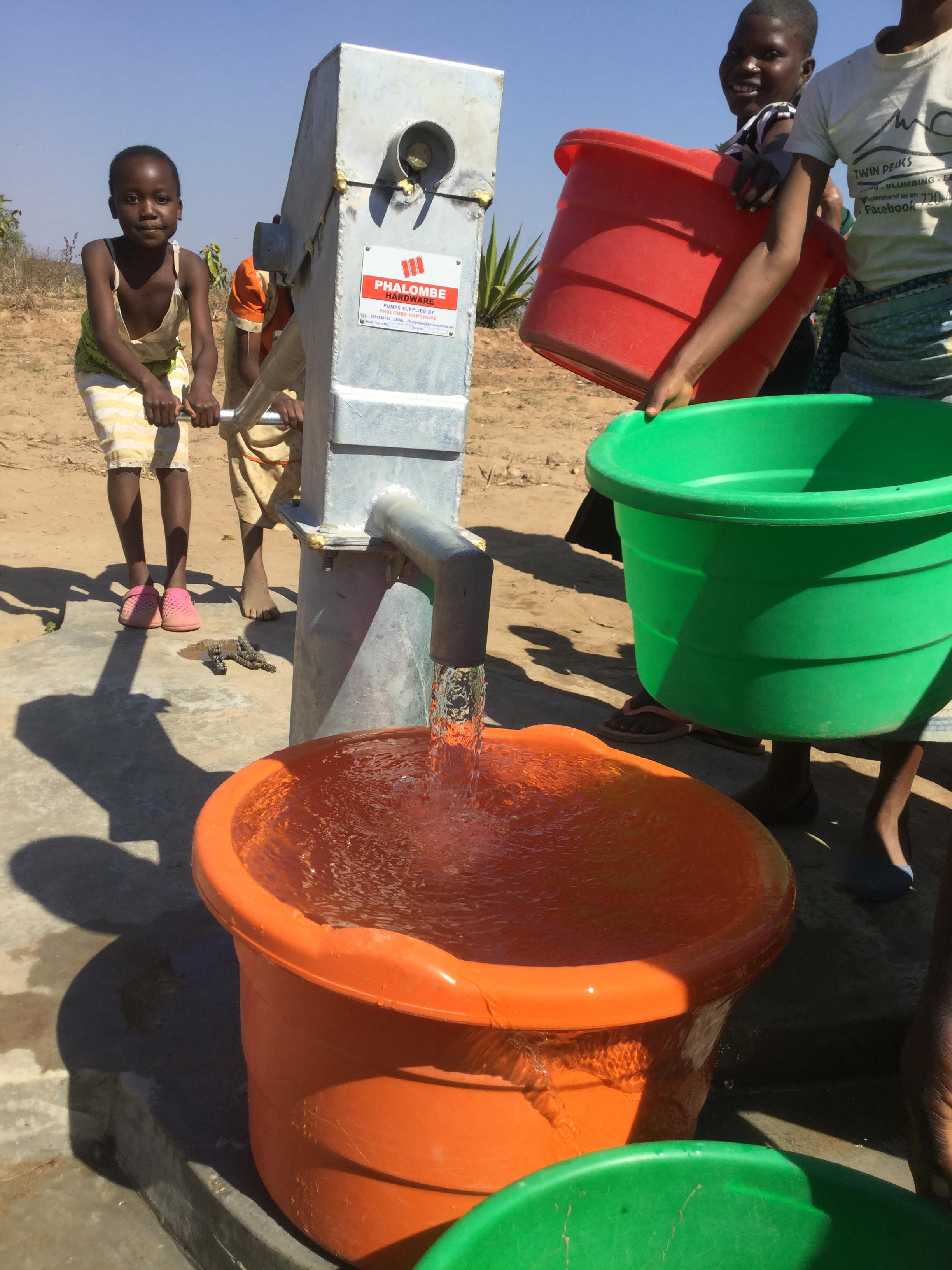 Image 9 girl pumping water